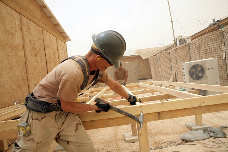 080606-N-9623R-162  IRAQ (June 6, 2008) Builder 2nd Class Jeffery Bivens, assigned to the ÒTiger TeamÓ of Naval Mobile Construction Battalion (NMCB) 17 hammers in sections of a sub-floor addition for a Marine Corps SYSCOM building. The Tiger Team is comprised of highly skilled Seabees with tools and materials who perform quality of life, safety and force protection upgrades to remote Marine outposts. U.S. Navy photo by Mass Communication Specialist 2nd Class Kenneth W. Robinson (Released)
